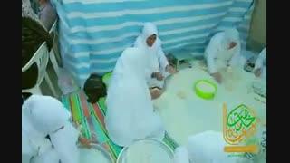 پخت نان صلواتی توسط گروهی از عاشقان امام رضا(علیهالسلام) در ایام دهه کرامت